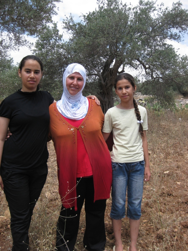 Jalela with two of her daughters in Niliin